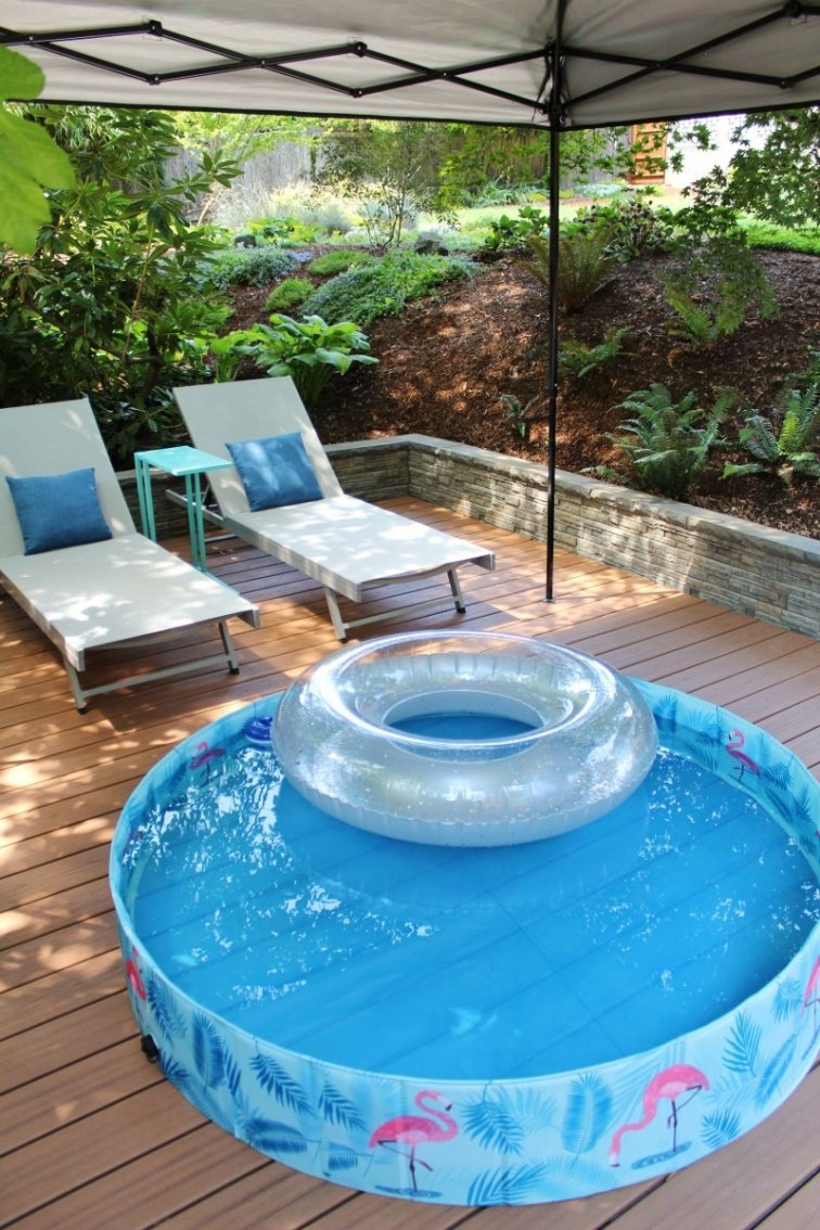 New Trex deck with relaxing kiddie pool and chaise lounge chairs