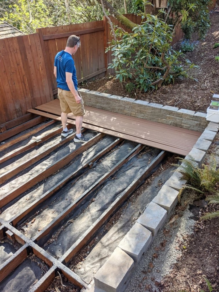 Inspecting and laying out Trex boards before building deck