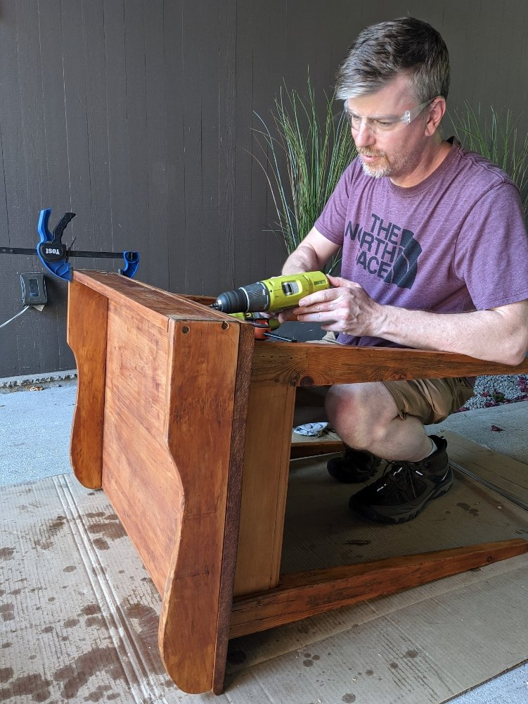 Flipping the back of the desk to hide the wood filler marks