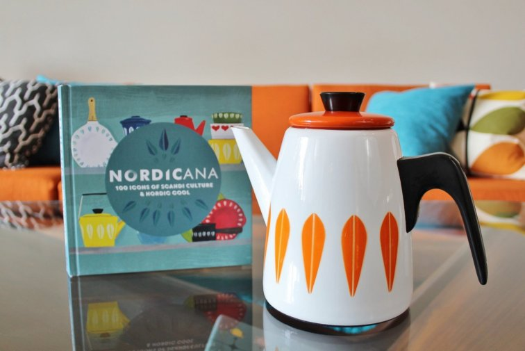 Cathrineholm coffee pot displayed with Nordicana book in mid-century modern living room