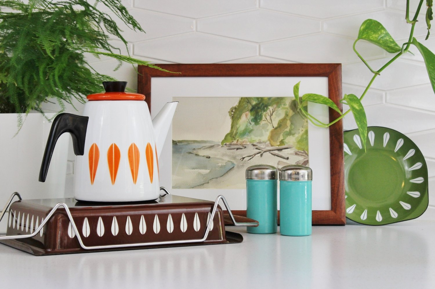 Cathrineholm lasagna pan, coffee pot and scampi dish in mid-century modern kitchen