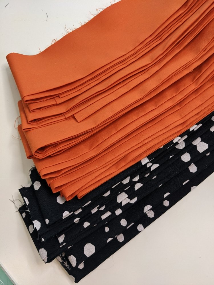 Orange, black and white Halloween fabric strips ironed