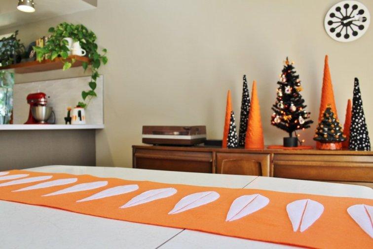 DIY felt table runner with white lotus shapes on orange felt