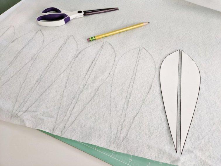 Tracing lotus shapes on white felt