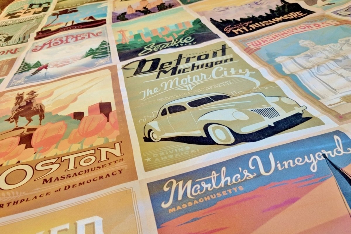 Retro travel poster art on guest room bedding