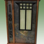 Custom Entry Light with house numbers and hardwood and tile accent.