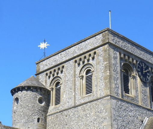 The tower stairway and the weathervane