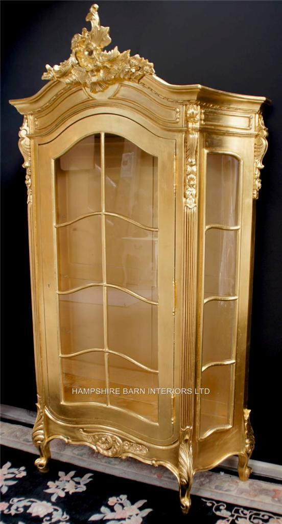 An Ornate SILVER LEAF DISPLAY CABINET ALSO IN GOLD LEAF