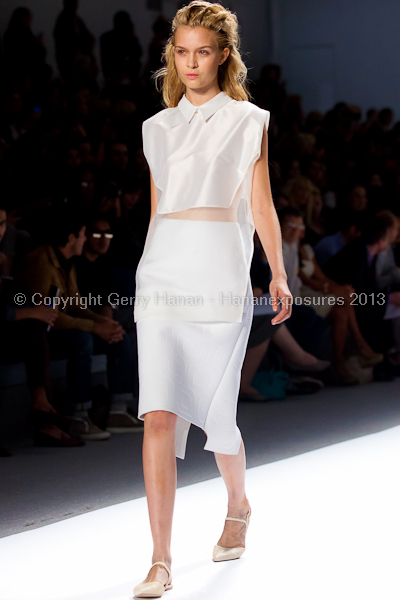 A model on the runway at the Osklen SS2013 show at New York Mercedes-Benz Fashion Week.