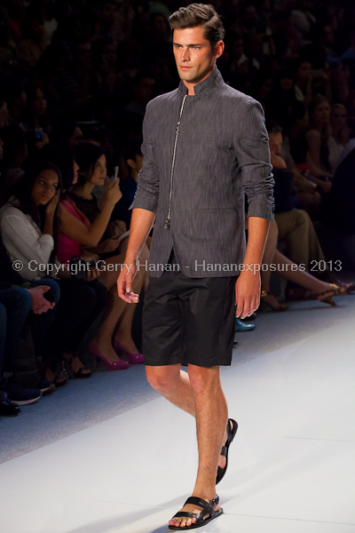 A model on the runway at the Vlov Qingqing Wu SS2013 show at New York Mercedes-Benz Fashion Week.