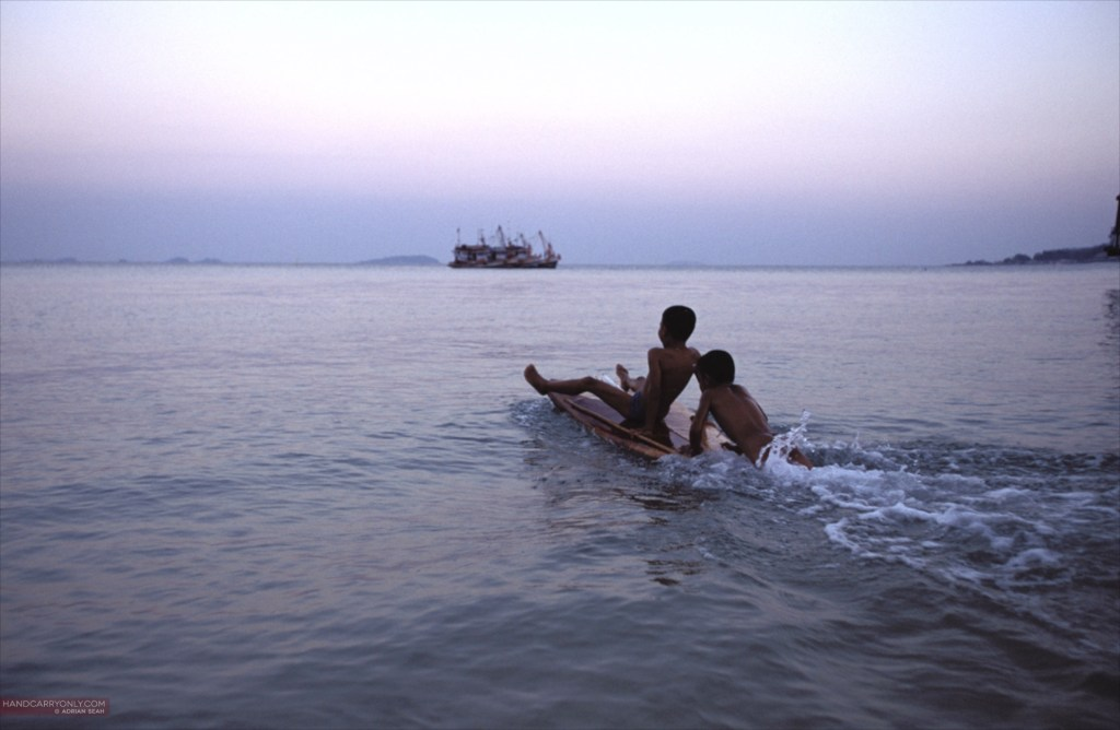 Kids playing on makeshift raft in thailand