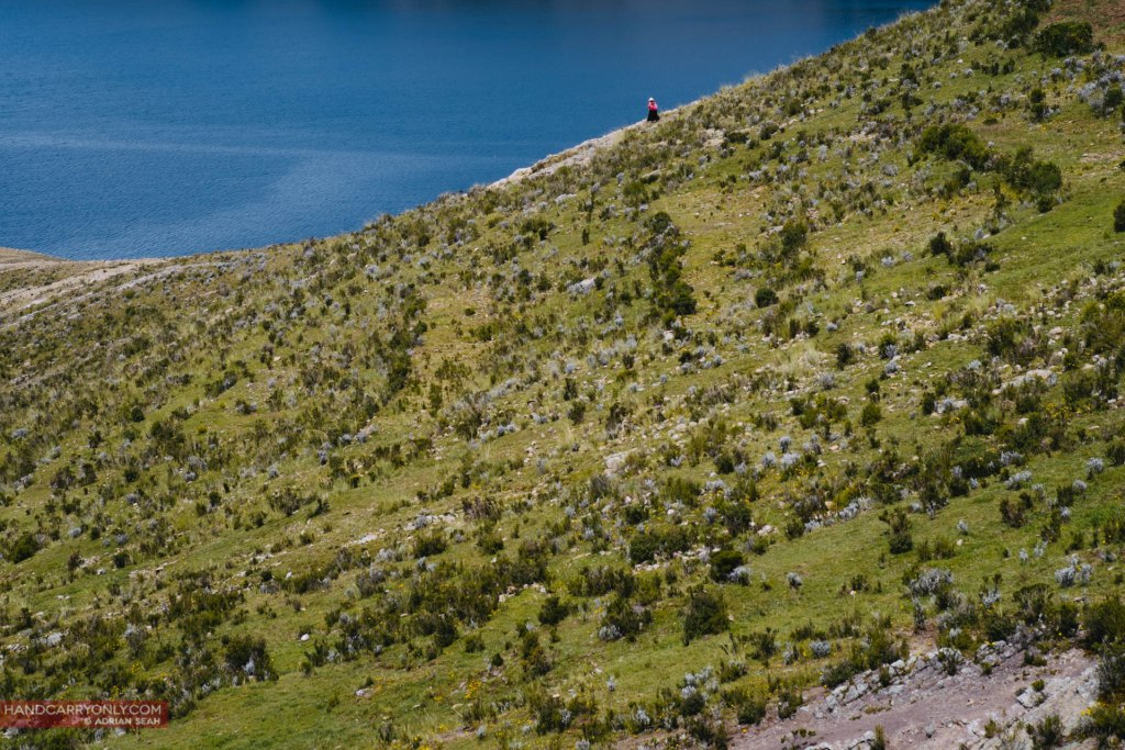 lady on slope isla del sol bolivia