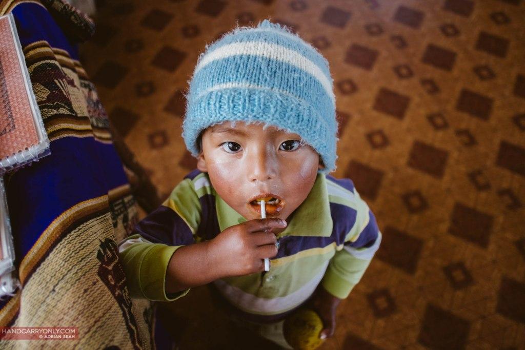 scruffy kid with lollipop isla del sol bolivia