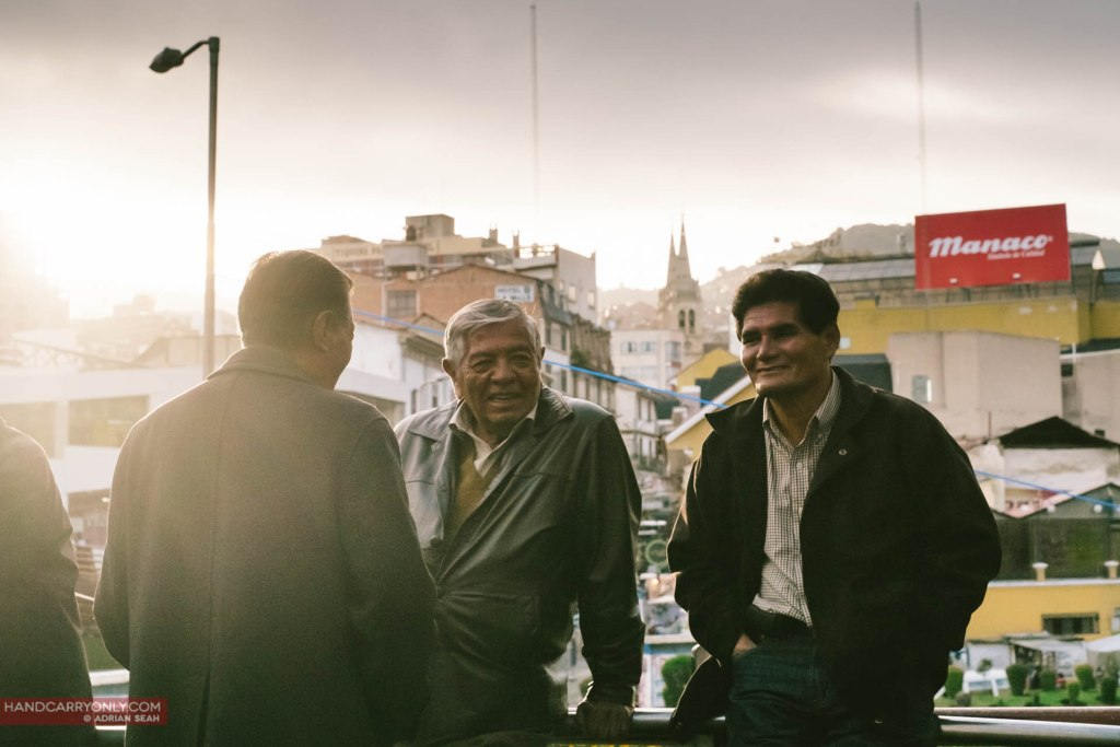 old men talking on a bridge in la paz bolivia