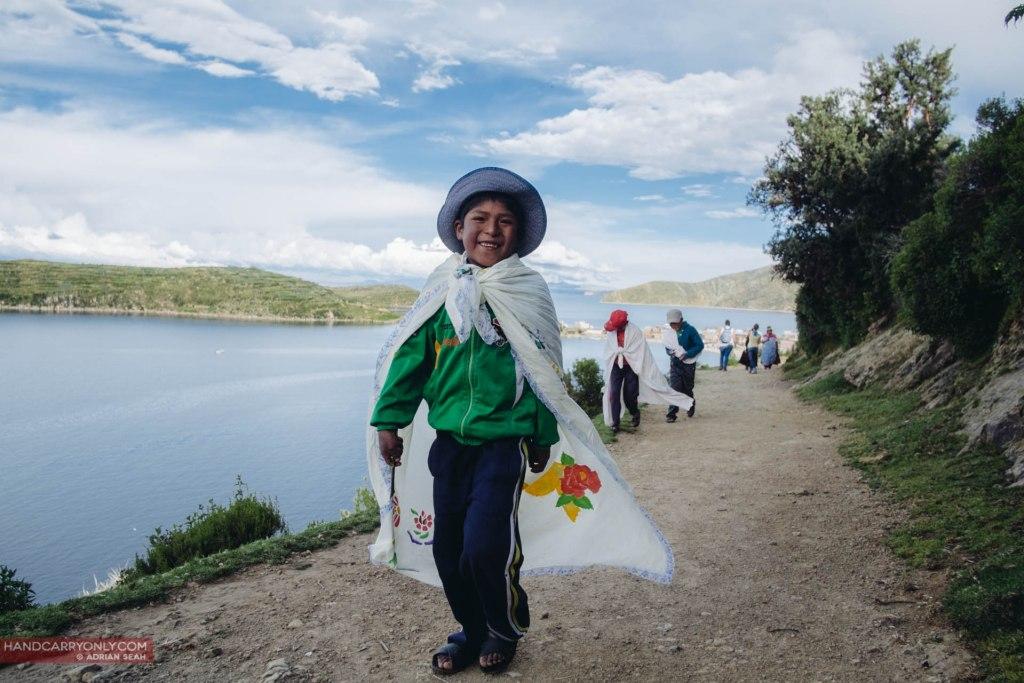 young boy in cape isla del sol bolivia