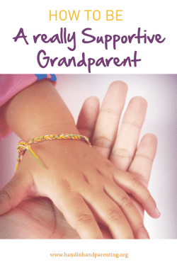 child's hand in grandparents hand