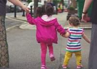 siblings sisters walking together