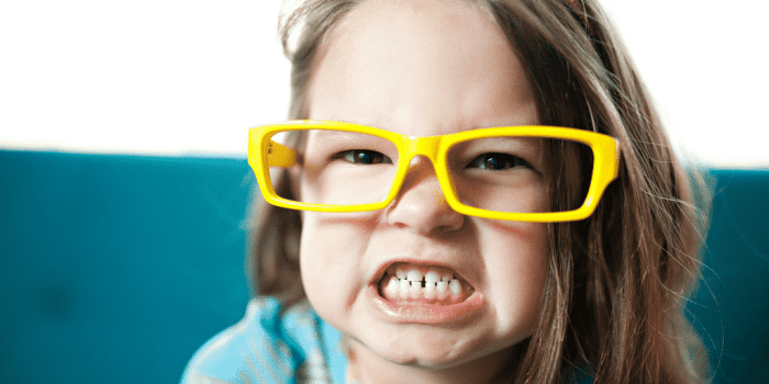 angry girl growling in post about using play to turn around a child's anger