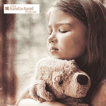 sad girl cuddling toy