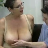 Busty teacher gives wanking lessons