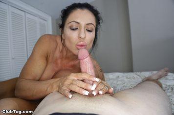 busty-older-woman-jacks-off-a-big-cock-04