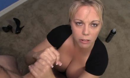 Busty milf demonstrates the art of giving a good handjob