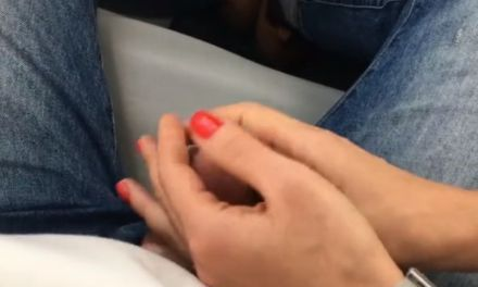 Girlfriend gives him a public handjob on a mini-bus