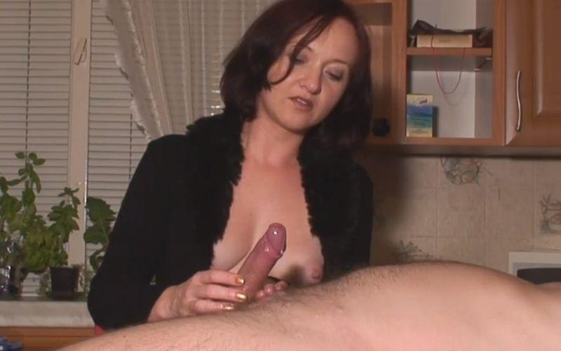 Mature housewife gives her handyman a femdom handjob