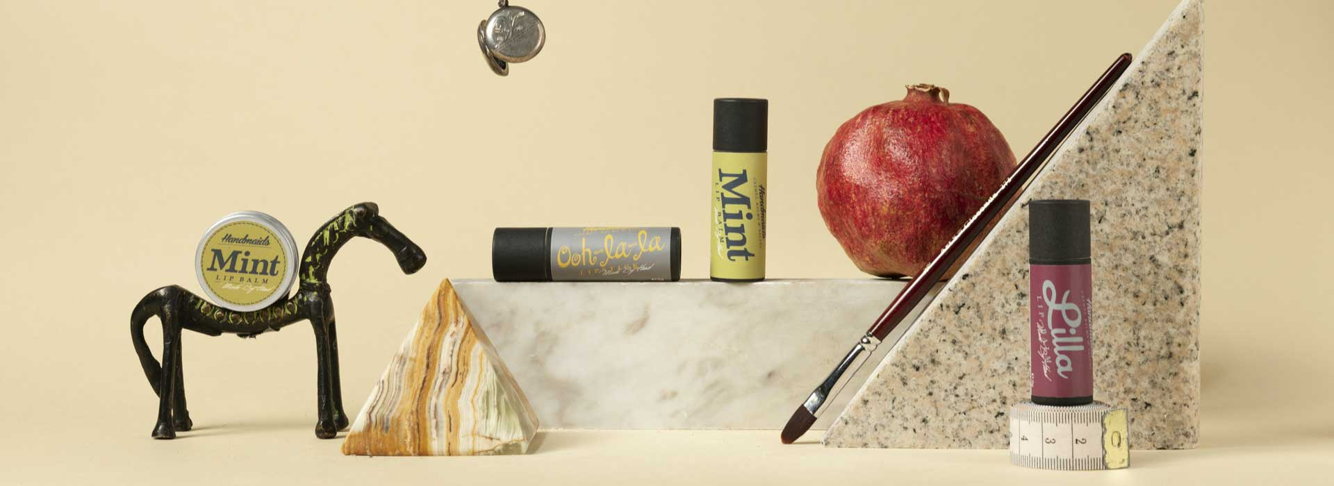 Lip balms in a lifestyle photography setup