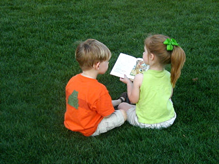 Future homeowners reading a book