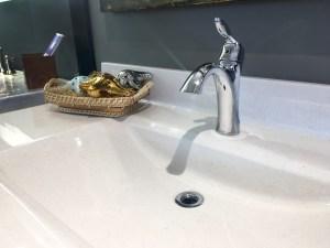 Shiny chrome post mount single handle faucet