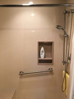 Custom shower with grab bars and hand shower