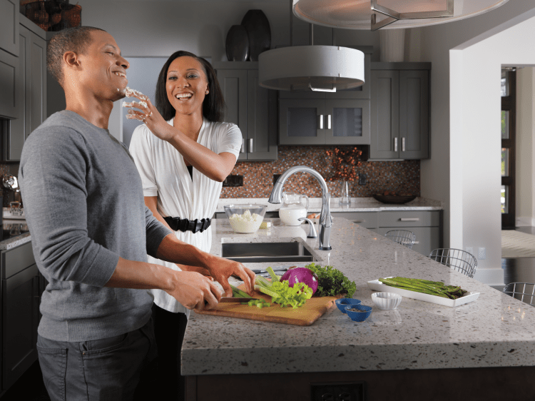Couple cooking in kitchen with prep sink