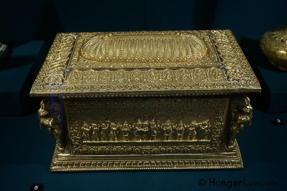 Address Casket Made from Gold and Sandalwood. It depicts Hindu faith figures. From the Area of Madurai, swami craftsmanwork. The corner figures are elephant headed lions called yalis 1875