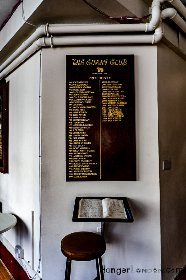 Presidents of the Curry Club plaque inside the bar lounge of the India Club
