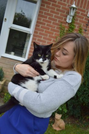 Hannah Gladwin with pet cat Mia, who is a female black and white cat