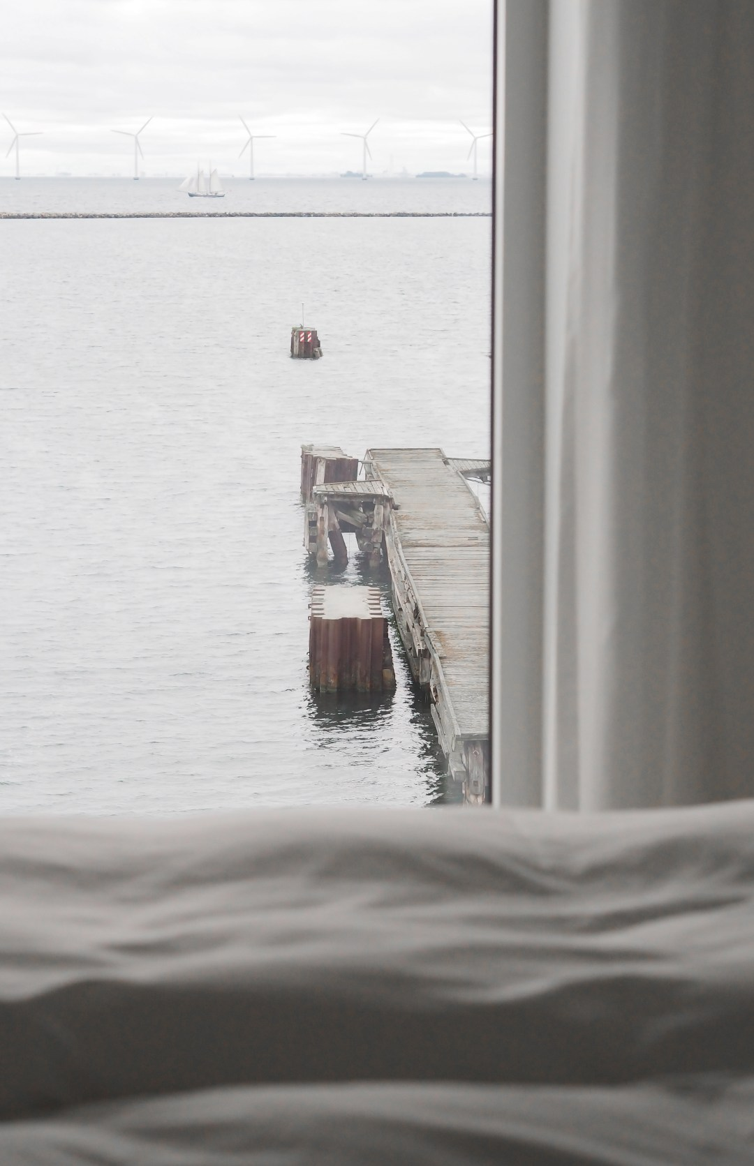 A sea view from the simple minimal Scandinavian bedroom