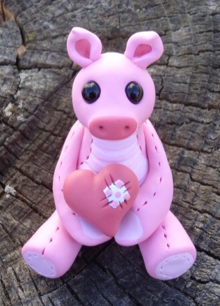 """""""Pig with a Heart"""" made of polymer clay and glass beads"""