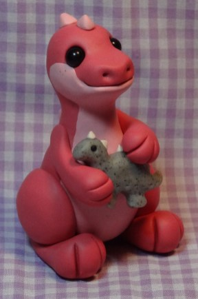 """""""Naptime Dinosaur"""" made of polymer clay and glass beads"""