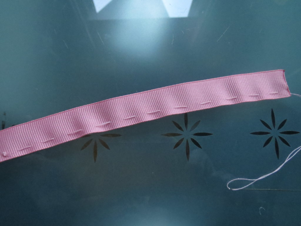 running stitch down the length of the ribbon