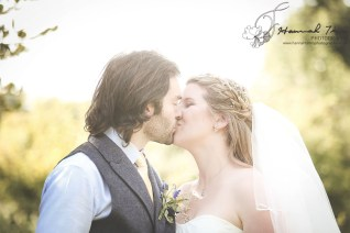 Bride & Groom kiss in sunshine