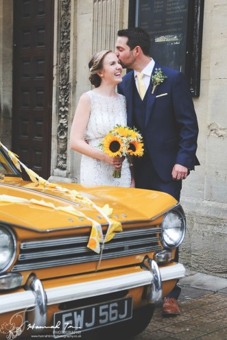 Bride & Groom with yellow Triumph