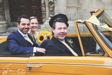 Bride & Groom with car