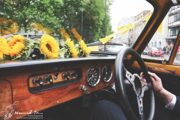 Inside yellow Triumph car