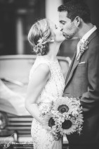 Bride & Groom kiss in black & white