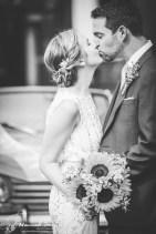 Bride & Groom kiss in black & white