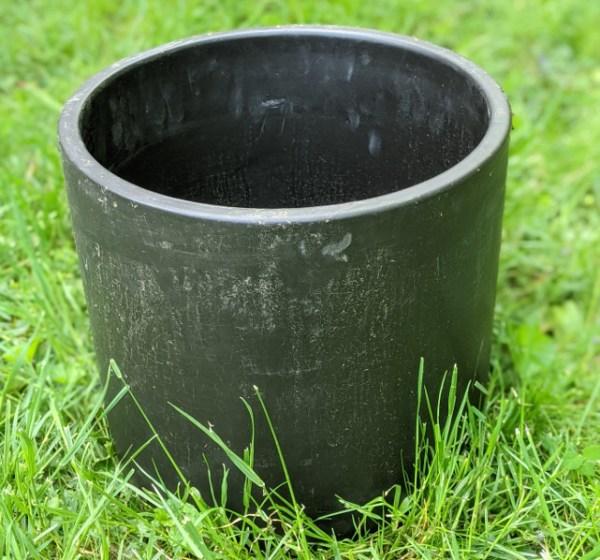 photo: black crock-shaped pot
