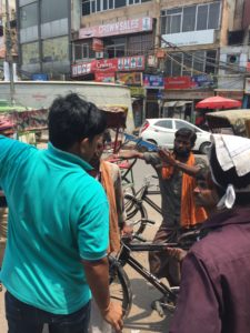 Prabhu negotiates with rickshaw drivers in Old Delhi, India