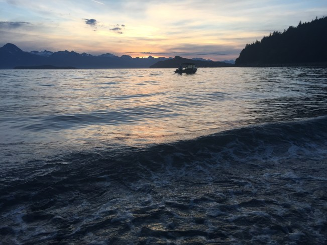 Footloose anchored at Handtroller Cove-Southeast Alaska. Chilkat Range in background.