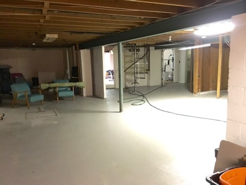 "A tour of our new house in all it's ""before photo"" glory. Unfinished basement with spiral staircase. 